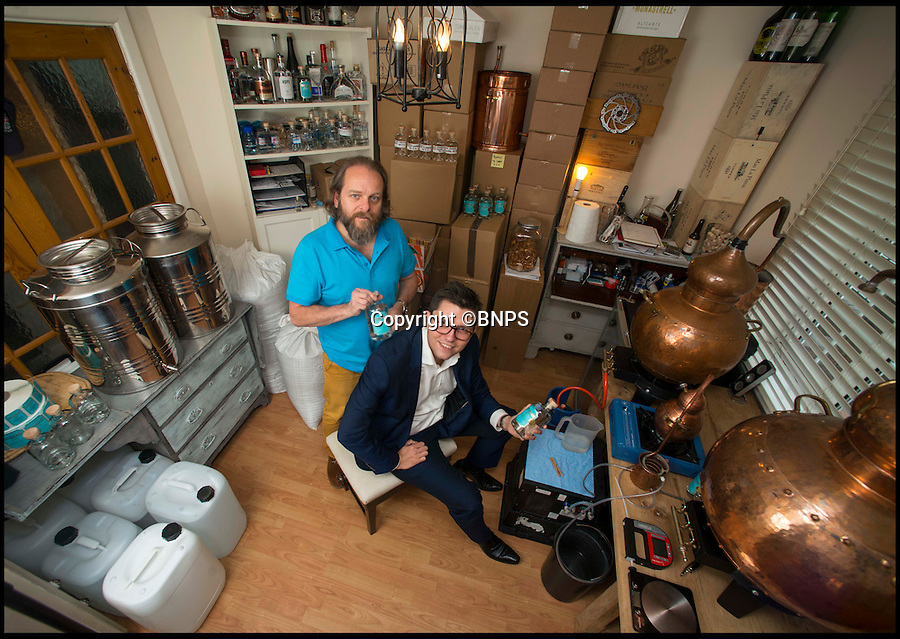 BNPS.co.uk (01202 558833)<br /> Pic: TomWren/BNPS<br /> <br /> Pals Martin Jennings (left) and Lukasz Dwornik in their distillery which is in the front room of Martin's house.<br /> <br /> Two friends are celebrating after they scooped the global drinks industry's top gong - with a gin they made in the spare room of their two-bed semi.<br /> <br /> Pals Martin Jennings and Lukasz Dwornik decided to dip their toes in gin-making after one too many sub-par G&amp;Ts in their local pub.<br /> <br /> The pair couldn't afford to open a specialist distillery so they bought an 35-litre copper still and made space for it in the spare room of Martin's house in Bournemouth, Dorset, by moving the sofa bed out.<br /> <br /> And their creation has just won the highest accolade at the San Francisco World Spirit Awards, considered to be the most respected and influential spirits competition in the world.