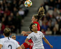 GRENOBLE, FRANCE - JUNE 15: Sarah Gregorius #11 of the New Zealand National Team and Janine Beckie #16 of the Canadian National Team battle for head ball during a game between New Zealand and Canada at Stade des Alpes on June 15, 2019 in Grenoble, France.