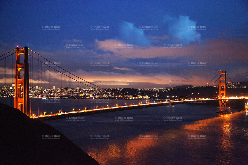 USA. California state. San Francisco. Traffic on the Golden Gate Bridge. Rush hour after sunset. The Golden Gate Bridge is a suspension bridge spanning the Golden Gate strait, the mile-wide, three-mile-long channel between San Francisco Bay and the Pacific Ocean. The structure links the U.S. city of San Francisco, on the northern tip of the San Francisco Peninsula, to Marin County, bridging both U.S. Route 101 and California State Route 1 across the strait. The bridge is one of the most internationally recognized symbols of San Francisco, California, and the United States. It has been declared one of the Wonders of the Modern World by the American Society of Civil Engineers. 15.12.2014 © 2014 Didier Ruef