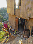 Typical hut built half on the steep mountainside. Chin refugees from Burma - Myanmar in Mizoram, Northeast India, 2006-2008