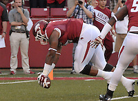 STAFF PHOTO BEN GOFF  @NWABenGoff -- 09/20/14 <br /> Arkansas defensive tackle Darius Philon recovers a Northern Illinois fumble before running it for a touchdown during the first quarter of the game in Reynolds Razorback Stadium in Fayetteville on Saturday September 20, 2014.