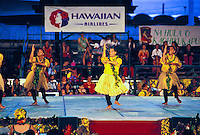 Hula dancers compete in the annual Merrie Monarch Festival. A week long cultural event starting on Easter weekend in the town of Hilo on the Big Island of Hawaii. The final competion is held in the Edith Kanakaole Tennis Stadium and attracts  thousa