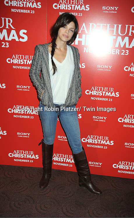 "Vanessa Ferlito posing for photographers at The New York Special Screening of ""Arthur Christmas"" on November 13, 2011 at The Clearview Chelsea Theatre in New York City."