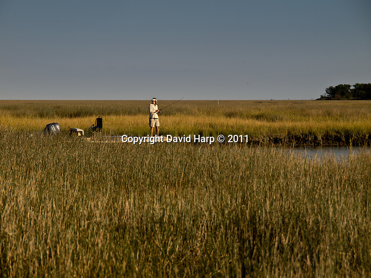 Bob Baugh fishes in a Smith Island marsh gut