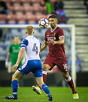 Marko Grujic of Liverpool takes on David Perkins of Wigan Athletic during the pre season friendly match between Wigan Athletic and Liverpool at the DW Stadium, Wigan, England on 14 July 2017. Photo by Andy Rowland.