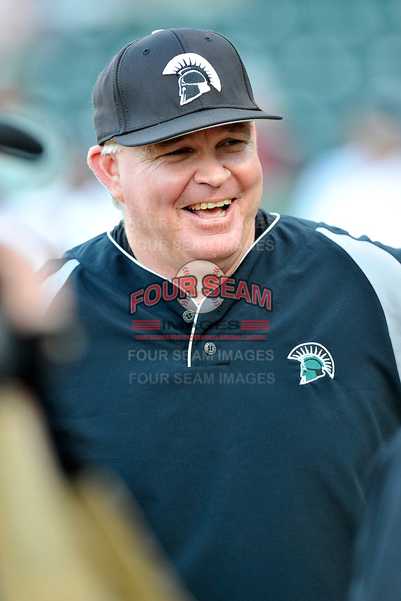 Head coach Matt Fincher of the USC Upstate Spartans laughs during the pregame conference with the umpires before a game against the South Carolina Gamecocks on Tuesday, March 15, 2016, at Fluor Field at the West End in Greenville, South Carolina. (Tom Priddy/Four Seam Images)