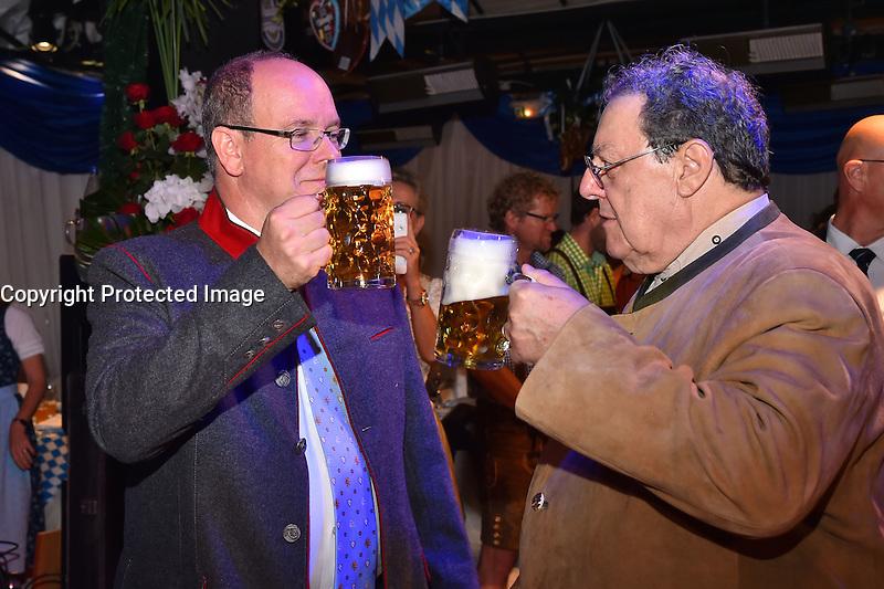 """--- NO TABLOIDS, NO WEB SITE --- Le Prince Albert II de Monaco, ‡ gauche, et Tonio Arcaini, de la brasserie Weihenstephan, participent ‡ la soirÈe d'ouverture de la 11Ëme Èdition de l'Oktoberfest au CafÈ de Paris le 14 octobre 2016. La SociÈtÈ des Bains de Mer cÈlËbre """"Oktoberfest"""" selon la pure tradition bavaroise, en partenariat avec la brasserie Weihenstephan, biËre munichoise. Les dinners se dÈroulent sous le chapiteau installÈ et†dÈcorÈ pour loccasion du 14 au 23 octobre 2016."""