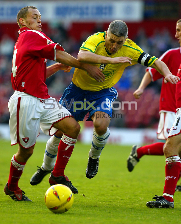 Pix, Shaun Flannery/SWpix. Nationwide League Division Two..Barnsley v Cardiff City, 9/11/2002..COPYRIGHT PICTURE>>SIMON WILKINSON>>01943 - 436649>>..Barnsley's Alex Neil halts the run of Cardiffs Graham Kavanagh.