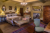 BNPS.co.uk (01202 558833)<br /> Pic: Savills/BNPS.<br /> <br /> One of the bedroom's at Athelhampton House.<br /> <br /> A grand country house is bracing itself for a huge influx of international visitors as its contents of antiques, furniture and paintings go on display ahead of an everything-must-go sale.<br /> <br /> The auction of a myriad of treasures inside Athelhampton House in Dorset, which is expected to raise over £1million, is being hailed as one of the best country house sales for a generation. <br /> <br /> The doors of the £7m Tudor mansion will be thrown open to visitors and potential bidders for four days from tomorrow (Sat).