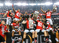 The Ohio State Buckeyes celebrate after the College Football Playoff National Championship between the Ohio State Buckeyes and the Oregon Ducks at AT&T Stadium in Arlington, Texas, Tuesday afternoon, January 13, 2015. The Ohio State Buckeyes defeated the Oregon Ducks 42 - 20. (The Columbus Dispatch / Eamon Queeney)