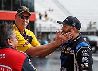 Jun 18, 2017; Bristol, TN, USA; NHRA announcer Alan Reinhart rubs the beard of top fuel driver Shawn Langdon during the Thunder Valley Nationals at Bristol Dragway. Mandatory Credit: Mark J. Rebilas-USA TODAY Sports