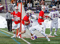 University at Albany Men's Lacrosse defeats Cornell 11-9 on Mar 4 at Casey Stadium. Connor Fields (#5) attacks.