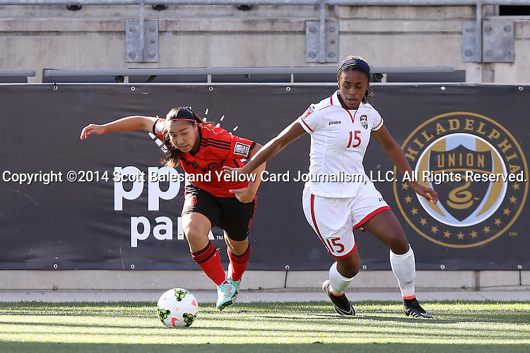 26 October 2014: Veronica Charlyn Corral (MEX) (9) and Liana Hinds (TRI) (15). The Trinidad & Tobago Women's National Team played the Mexico Women's National Team at PPL Park in Chester, Pennsylvania in the 2014 CONCACAF Women's Championship Third Place game. Mexico won the game 4-2 after extra time. With the win, Mexico qualified for next year's Women's World Cup in Canada and Trinidad & Tobago face playoff for spot against Ecuador.