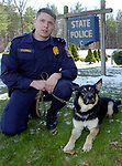 FILE.....State Trooper James O'Donnell and his dog Arek, outside of Troop C in Tolland Wednesday. A Jim Michaud pic 4/5/06