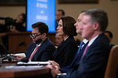 Former National Security Council Russia expert Fiona Hill and Counselor for Political Affairs at the U.S. Embassy in Ukraine David Holmes listen to opening remarks prior to their testimony before the U.S. House Permanent Select Committee on Intelligence on Capitol Hill in Washington D.C., U.S., on Thursday, November 21, 2019.<br /> <br /> Credit: Stefani Reynolds / CNP
