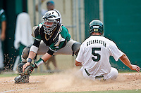 April 23, 2011:    Jacksonville University Dolphins outfielder Dan Gulbransen (5) slides to homeplate safely under the tag of Stetson Hatters catcher Nick Rickles (9) during Atlantic Sun Conference action between Stetson Hatters and Jacksonville University Dolphins at John Sessions Stadium in Jacksonville, Florida.  Jacksonville defeated Stetson 10-4...........