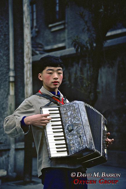 Boy Playing Accordion At Deaf School