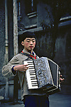 Boy Playing Accordion At Deaf School