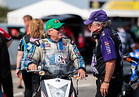 Sep 29, 2019; Madison, IL, USA; NHRA funny car driver John Force (left) talks with John Medlen during the Midwest Nationals at World Wide Technology Raceway. Mandatory Credit: Mark J. Rebilas-USA TODAY Sports