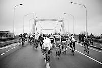 peloton over bridge<br /> <br /> Omloop Het Nieuwsblad 2014