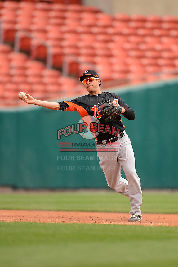 Norfolk Tides third baseman Danny Valencia #22 throws to first during a game against the Buffalo Bisons on May 9, 2013 at Coca-Cola Field in Buffalo, New York.  Norfolk defeated Buffalo 7-1.  (Mike Janes/Four Seam Images)