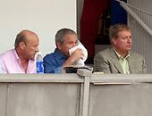 Washington, D.C. - July 4, 2007 -- United States President George W. Bush consumes a beverage as he watches the Chicago Cubs play the Washington Nationals at RFK Stadium in Washington on Thursday, July 7, 2007. With Bush, center, are Nationals President Stan Kasten, left, and Nationals General Manager Jim Bowden, right.   <br /> Credit: Roger L. Wollenberg - Pool via CNP