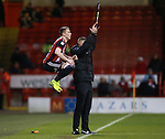 Caolan Lavery of Sheffield Utd jumps high as he waits to come on during the Championship match at Bramall Lane Stadium, Sheffield. Picture date 26th December 2017. Picture credit should read: Simon Bellis/Sportimage