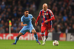 Gael Clichy of Manchester City pressures Arjen Robben of Munich - Manchester City vs. Bayern Munich - UEFA Champion's League - Etihad Stadium - Manchester - 25/11/2014 Pic Philip Oldham/Sportimage