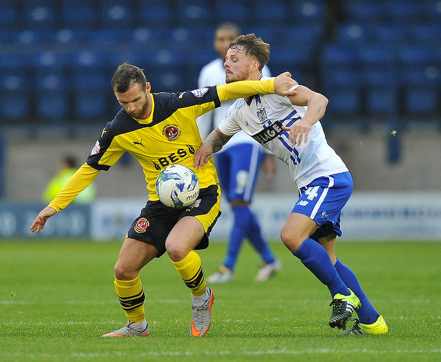 Fleetwood Town's Jimmy Ryan battles with Bury's Andrew Tutte<br /> <br /> Photographer Dave Howarth/CameraSport<br /> <br /> Football - The Football League Sky Bet League One - Bury v Fleetwood Town - Tuesday 18th August 2015 - Gigg Lane - Bury<br /> <br /> &copy; CameraSport - 43 Linden Ave. Countesthorpe. Leicester. England. LE8 5PG - Tel: +44 (0) 116 277 4147 - admin@camerasport.com - www.camerasport.com