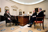 United States President Ronald Reagan, left, meets with U.S. Secretary of State George Shultz (center) and Robert McFarlane, Assistant to the President for National Security Affairs, right, in the Oval Office of the White House in Washington, D.C. on Friday, January 4, 1985.  It was Shultz and McFarlane's final meeting with the President before their departure for Geneva..Mandatory Credit: Jack Kightlinger - White House via CNP