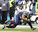 Seattle Seahawks running back Bryce Brown (36) lowers a shoulder on St. Louis Rams cornerback Janoris Jenkins (21) at CenturyLink Field in Seattle, Washington on December 27, 2015.  The Rams beat the Seahawks 23-17.      ©2015. Jim Bryant Photo. All Rights Reserved