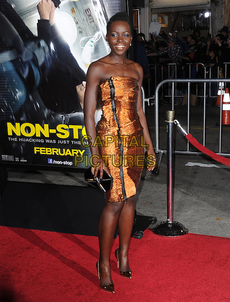 LOS ANGELES, CA - FEBRUARY 24 -Lupita Nyong'o attends Universal Pictures' Non-Stop held at Regency Village Theatre in Westwood, California on February 24,2014                                                                               <br /> CAP/DVS<br /> &copy;DVS/Capital Pictures