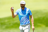 Dustin Johnson reacts after putting on the 18th green during the 2016 U.S. Open in Oakmont, Pennsylvania on June 17, 2016. (Photo by Jared Wickerham / DKPS)