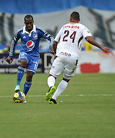 BOGOTA- COLOMBIA -19 -04-2014: Dhawlin Leudo (Izq.) jugador de Millonarios disputa el balón con Felix Noguera (Der.) jugador de Deportes Tolima durante partido entre Millonarios y Deportes Tolima por la fecha 18 entre de la Liga Postobon I 2014, jugado en el estadio Nemesio Camacho El Campin de la ciudad de Bogota. / Dhawlin Leudo (L) player of Millonarios Fe vies for the ball with Felix Noguera (R) player of Deportes Tolima during a match between Millonarios and Deportes Tolima for the date 18th of the Liga Postobon I 2014 at the Nemesio Camacho El Campin Stadium in Bogota city. Photo: VizzorImage  / Luis Ramirez / Staff.