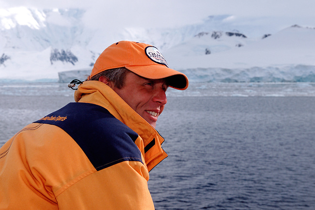 Passenger on a Quark expedition trip in the smart yellow jacket with slogan on the shoulders