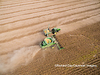 63801-08805 Soybean Harvest, John Deere combine unloading soybeans into grain cart while harvesting - aerial Marion Co. IL
