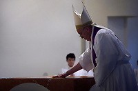 Pope Francis anoints the altar with Holy Chrism as he performs an altar dedication ritual during a pastoral visit to the renovated parish of San Giulio in Monteverde on April 7, 2019 in Rome.