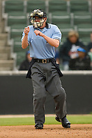 Home plate umpire Brian Debraywere makes a strike call during a South Atlantic League game between the Lexington Legends and the Kannapolis Intimidators at Fieldcrest Cannon Stadium April 14, 2010, in Kannapolis, North Carolina.  Photo by Brian Westerholt / Four Seam Images