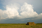 Hay rolls, building afternoon thunder storm in rural Stutsman County, North Dakota...