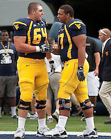 September 4, 2010:  WVU offensive linemen Don Barclay (64) and Josh Jenkins (77). The West Virginia Mountaineers defeated the Coastal Carolina Chanticleers 31-0 on September 4, 2010 at Mountaineer Field, Morgantown, West Virginia.