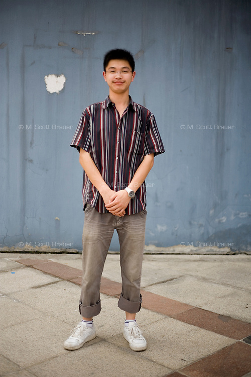 Cenqi, a student, age 24, poses for a portrait in Nanjing. Response to 'What does China mean to you?': 'China includes Taiwan, where Chinese people reside, and it is the abbreviation of the People's Republic of China.'  Response to 'What is your role in China's future?': 'I am a builder of China's future, just like a component of an airplane, with me China will soar even farther in the future.'