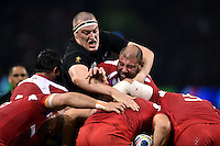 Brodie Retallick of New Zealand wrestles with Giorgi Chkhaidze of Georgia at a maul. Rugby World Cup Pool C match between New Zealand and Georgia on October 2, 2015 at the Millennium Stadium in Cardiff, Wales. Photo by: Patrick Khachfe / Onside Images