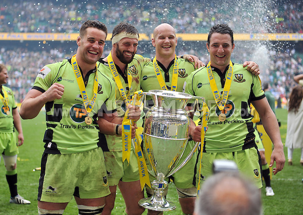 Calum Clark, Tom Wood, Sam Dickinson and Phil Dowson with the Aviva Premiership trophy. Aviva Premiership Final, between Saracens and Northampton Saints on May 31, 2014 at Twickenham Stadium in London, England. Photo by: Patrick Khachfe / JMP
