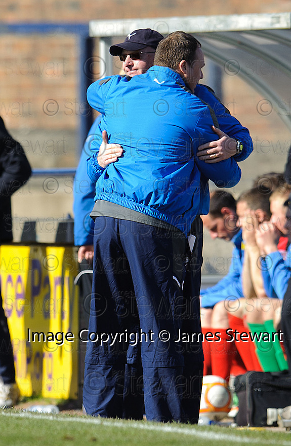 Raith Rover's manager John McGlynn and assistant Paul Smith at the end of the game.