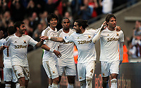 Saturday, 20 October 2012<br /> Pictured: Michu of Swansea (R) celebrating with fellow players L-R Angel Rangel, Ki Sung Yueng, Ashley Williams and Chico Flores.<br /> Re: Barclays Premier League, Swansea City FC v Wigan Athletic at the Liberty Stadium, south Wales.