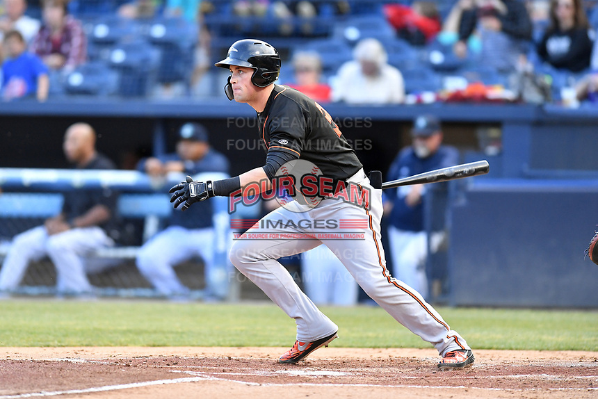 Delmarva Shorebirds first baseman Seamus Curran (34) swings at a pitch during a game against the Asheville Tourists at McCormick Field on May 3, 2019 in Asheville, North Carolina. The Shorebirds defeated the Tourists 6-5. (Tony Farlow/Four Seam Images)