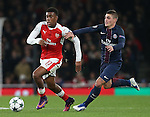 Arsenal's Alex Iwobi tussles with PSG's Marco Verratti during the Champions League group A match at the Emirates Stadium, London. Picture date November 23rd, 2016 Pic David Klein/Sportimage