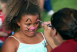 Lilyanne Lee, 7, gets her face painted at the Boys and Girls Club of Western Nevada booth at the 11th annual National Night Out hosted by the Carson City Sheriff's Office in Carson City, Nev., on Tuesday, Aug. 6, 2013. <br />