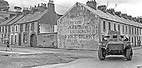 British Army armoured vehicle on patrol in the Bogside, Londonderry, N Ireland, UK. The notice on the gable wall of a row of terrace houses bears the legent: You are now entering Free Derry. 19690900234.<br />