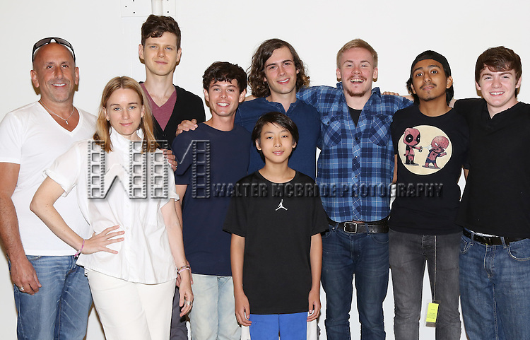 Director Scott Elliott, Emily Cass McDonnell, Peter Mark Kendall, Paul Iacono, Zane Pais, Bradley Fong, Sea McHale, Tony Revolori and Jack DiFalco attend the first day rehearsal for the New Group production of 'Mercury Fur' at the New 42nd Street Studios on July 6, 2015 in New York City.